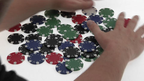 A poker player's hands gather a pile of poker chips Stock Video Footage