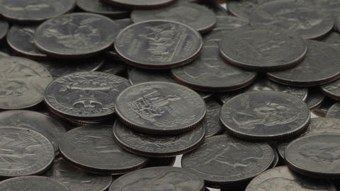 Quarters lay in a pile on a white surface Stock Video Footage