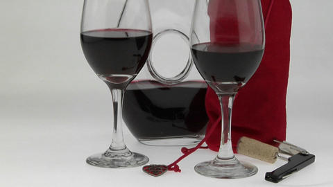 glasses filled with red wine and surrounded by a... Stock Video Footage