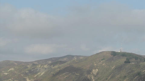 Passing clouds cast shadows on mountaintops Stock Video Footage