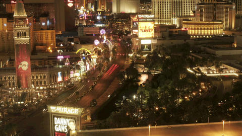 Traffic moves along a Las Vegas street at night Footage
