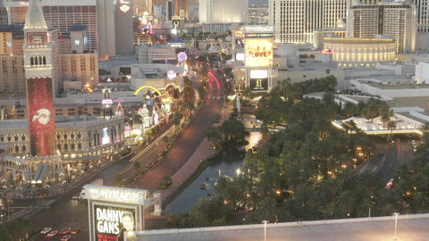 Traffic moves along a Las Vegas street at night Stock Video Footage