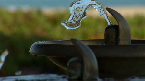 Water fountains emit spurts of water alternately Stock Video Footage