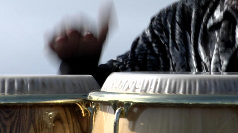 A man plays the bongo drums Stock Video Footage