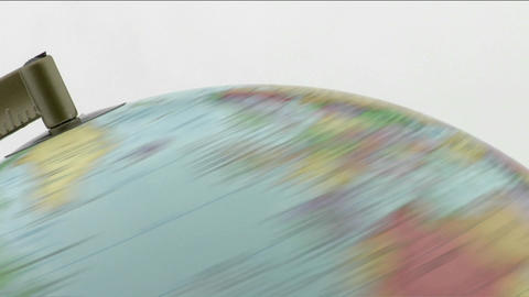 The top of a globe is viewed as it spins Stock Video Footage