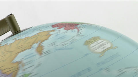 The top of a globe is viewed as it spins Footage