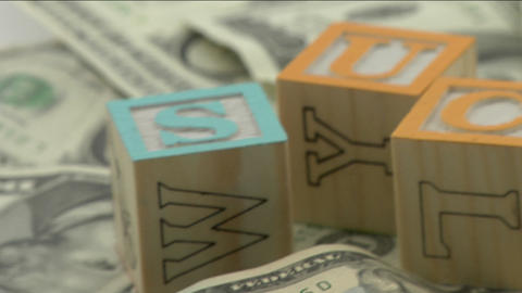 "Arranged wood blocks spell out the word success"" on top... Stock Video Footage"