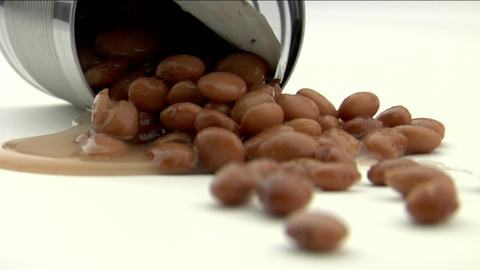Spilled beans lay on a white floor Stock Video Footage