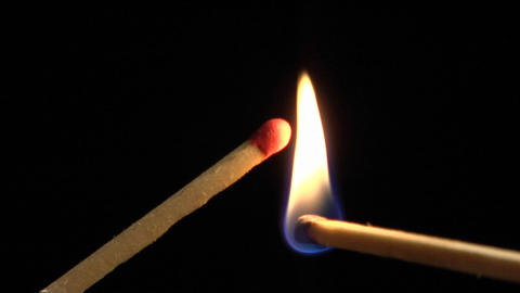 One matches flame lights another match Stock Video Footage