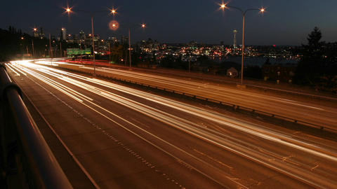 Traffic drives along a Seattle freeway at night Stock Video Footage