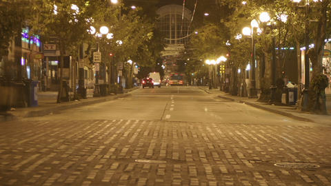 Traffic drives through a downtown area in time lapse Footage