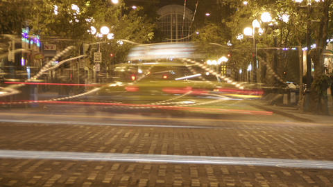 Traffic drives through a downtown area in time lapse Stock Video Footage