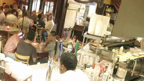 A panning shot across a busy bar in time lapse Stock Video Footage