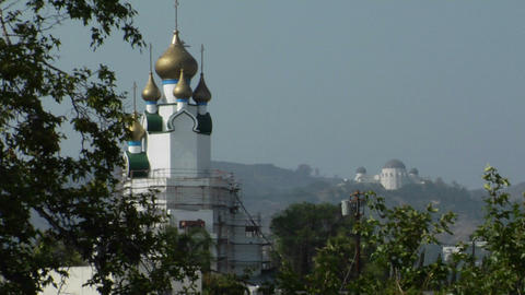Golden domes adorn the exterior of a Style-style building Footage