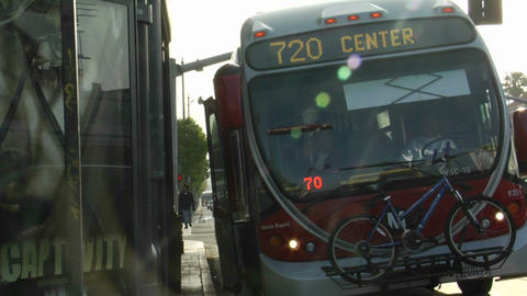 A man boards a metro bus that drives away Stock Video Footage