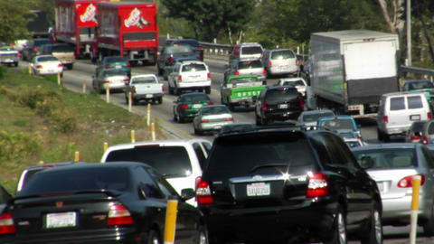 Heavy traffic moves bumper-to-bumper along a four-lane... Stock Video Footage