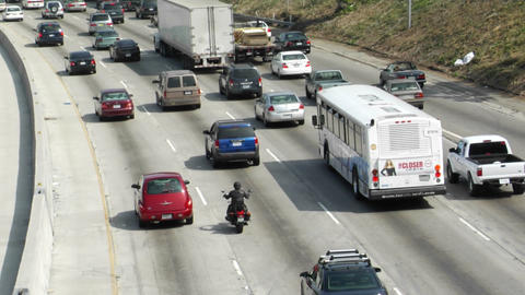 Traffic moves slowly along a busy freeway Footage