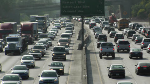 Traffic moves slowly on a busy freeway Footage