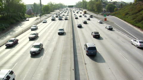 Traffic moves along a busy freeway Footage