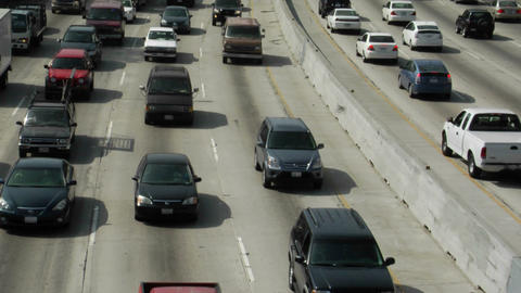 Traffic moves along a busy freeway Stock Video Footage