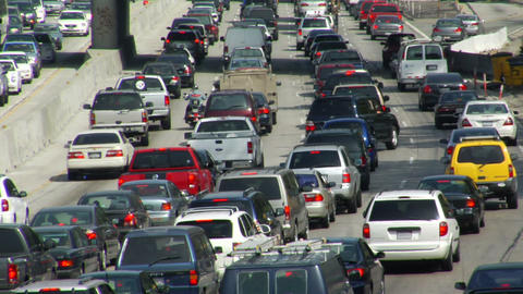 Traffic moves slowly on a congested freeway Stock Video Footage