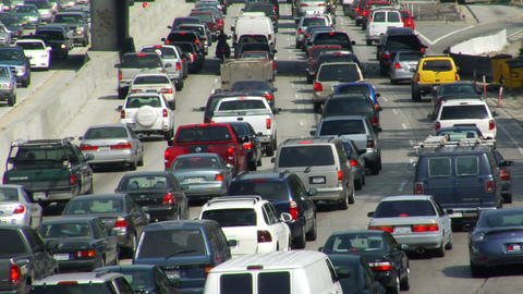 Traffic moves slowly on a congested freeway Footage