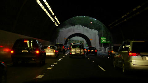 Traffic drives on a highway and through tunnels Footage