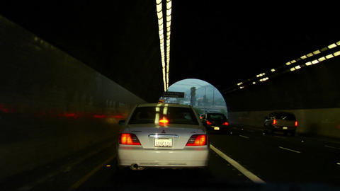 Traffic drives on a highway and through tunnels Stock Video Footage