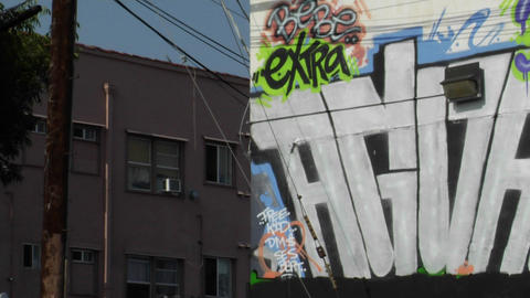 Graffiti decorates the wall of a building Footage
