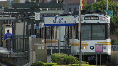Subway trains stop at a station to pick up passengers Stock Video Footage