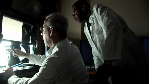 doctors discuss the results of an x-ray Stock Video Footage