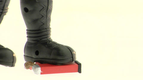 The boots of an action figure knocks over a plastic... Stock Video Footage