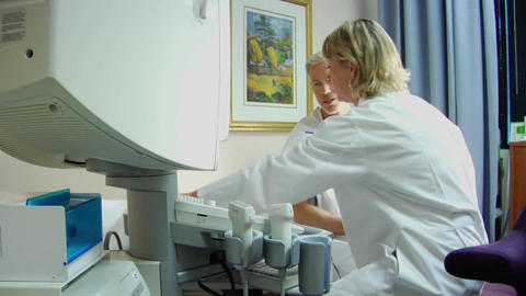 A doctor prepares a patient for a medical test Stock Video Footage