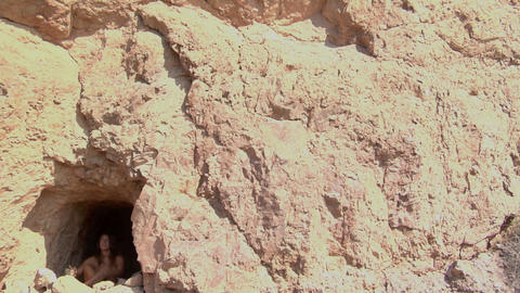 A woman sits and prays in a cave Stock Video Footage