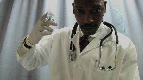 A doctor prepares to administer an injection with a needle Footage
