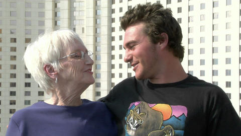 A man give his grandmother a hug Stock Video Footage