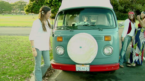 A Dalmatian in a VW Bus watches women outside Stock Video Footage
