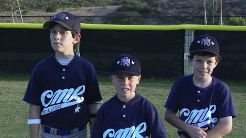 Young baseball players cross their arms and pose Stock Video Footage