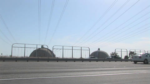 Traffic passes a nuclear facility Stock Video Footage