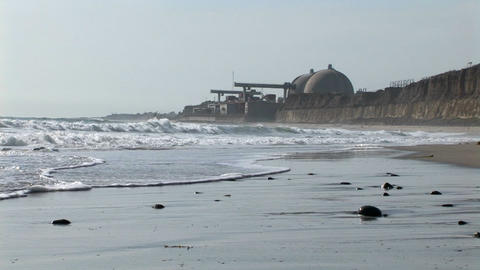 A power plant sits on the coast Footage