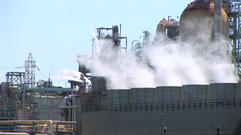 Steam rises from evaporative stacks at a power facility Stock Video Footage