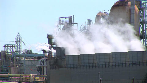 Steam rises from evaporative stacks at a power facility Footage