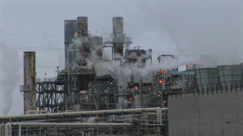 Steam emits from an industrial plant Stock Video Footage