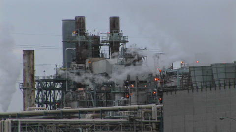 Steam emits from an industrial plant Footage