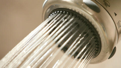 A shower head turns on, then off Stock Video Footage