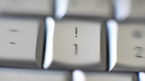 The number 1 key on a keyboard comes into focus Footage