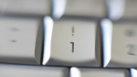 The number 1 key on a keyboard comes into focus Stock Video Footage
