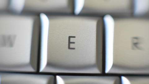 The letter E on a keyboard comes into focus Footage