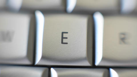 The letter E on a keyboard comes into focus Stock Video Footage