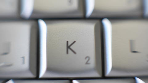 The letter K is brought out on a computer keyboard Footage